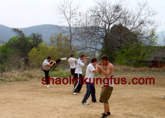 Students training Chinese kickboxing on song mountain of Shaolin temple
