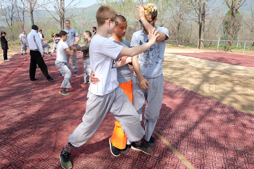 The Master teaching the Shaolin applications performance.